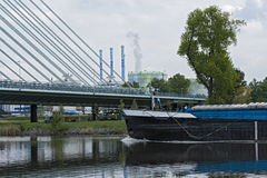 Cargo ship on the main river in front of an industrial area in Frankfurt, Germany Stock Photos