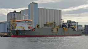 Cargo ship moored in front of silo building in Stavanger Stock Photography
