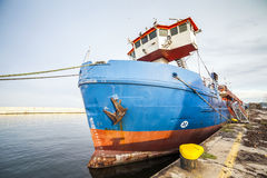 Cargo ship moored in a harbor Royalty Free Stock Images