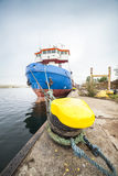 Cargo ship moored in a harbor Royalty Free Stock Photo