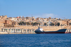 The cargo ship moored in the harbor Valletta. Malta Stock Photos
