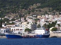 Cargo ship moored on a pier of greece maritime town. stock photos