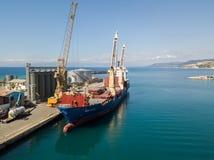Cargo ship moored at the pier of the port of Vibo Marina, Calabria, Italy. 07/06/2017 stock photography