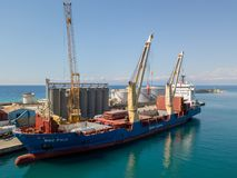 Cargo ship moored at the pier of the port of Vibo Marina, Calabria, Italy. 07/06/2017 royalty free stock images