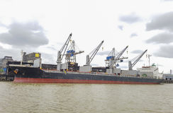 Cargo ship moored in port during cargo operations royalty free stock photos