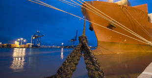 Cargo ship moored in port by night. Bow of Container ship in Brazilian port. no logos or trademarks on the picture Royalty Free Stock Image