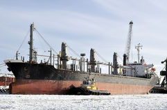 Cargo ship moored to port in the winter time Stock Image