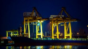 Cargo ship. Moving load at port at nightStock .4K timelapse stock video footage