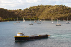 Cargo ship near Caribbean island Stock Image