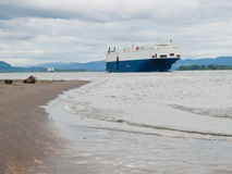 Cargo ship near shore on the Columbia River Royalty Free Stock Photo