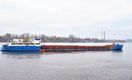 Cargo ship on Neva River. Cargo ship on Neva River on the outskirts of St. Petersburg at cloud day, Russia Stock Photography