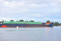 Cargo ship on the Neva river. Cargo ship on the Neva river in outskirts of St.Petersburg, Russia Royalty Free Stock Images