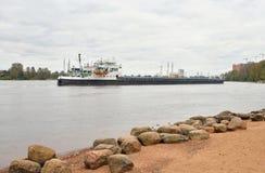 Cargo ship on the Neva river. Stock Photos