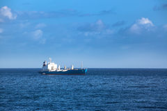 Cargo ship in the ocean Stock Images