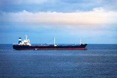 Cargo ship in the ocean Royalty Free Stock Images