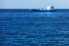 Cargo ship in ocean Stock Photos
