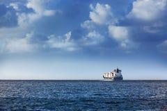A cargo ship. Cargo ship in the ocean in the sky Royalty Free Stock Photo