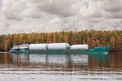 The cargo ship `Oka 53`, river Volga, in Vologda oblast. Of The Russian Federation. 29 Sep 2017. The cargo ship loaded with contai. The cargo ship `Oka 53` Royalty Free Stock Photos