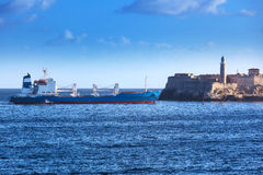 Cargo ship and old fortress Royalty Free Stock Photo