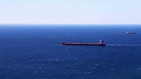 Cargo ship in the open ocean stock video footage