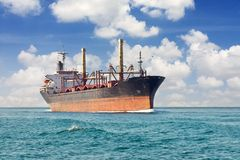 Cargo ship at open sea Stock Images
