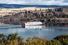 Cargo ship paddling upriver Royalty Free Stock Images