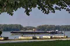 Cargo ship pass along the Ruse port at Danube river Royalty Free Stock Images