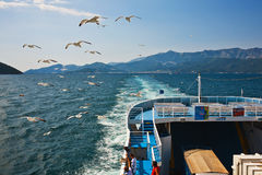 Cargo ship and passengers Royalty Free Stock Photo