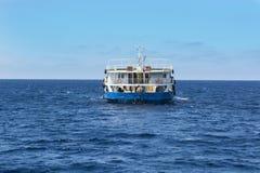 Cargo ship passes the strait Royalty Free Stock Photos
