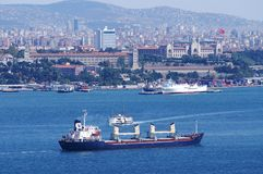 Cargo ship passing through bospurus strait. The other side is istanbul asia part royalty free stock image