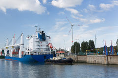 Cargo ship passing lock in Antwerp port Royalty Free Stock Images