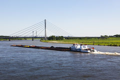 Cargo ship passing new Rhine bridge at Wesel Royalty Free Stock Image