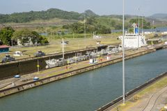 Cargo ship passing through Panama Canal Royalty Free Stock Photography