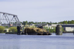 Cargo ship passing through a swing bridge Royalty Free Stock Photography