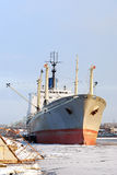 Cargo ship in the port. In winter royalty free stock images