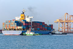 Cargo ship at the port arriving. With push boat working Stock Photography