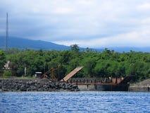 Cargo ship in port in Bali royalty free stock photo