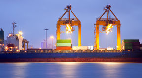 Cargo ship in port at dusk Royalty Free Stock Photo