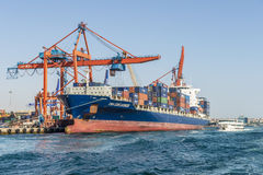Cargo ship in the port of Istanbul. Royalty Free Stock Images