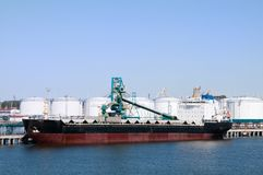 Cargo ship in port on loading Stock Images