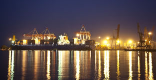 Cargo ship in the port at night Stock Photo