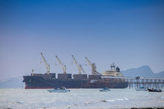Cargo ship at port. On sea Stock Photo