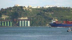 Cargo ship at the port. Cargo ship under the bridge stock video footage