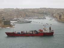 Cargo ship at port of Valletta royalty free stock images