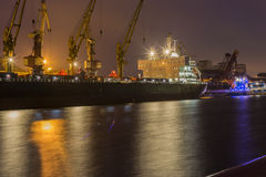 Cargo ship in the port of Ventspils, Latvia. At night Stock Photos