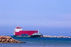 Cargo ship with red containers stock photography
