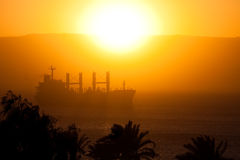 Cargo Ship in the Red Sea 1. A ship in the Red Sea in the sunset. Photo taken from Aqaba, Jordan stock photo