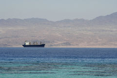 Cargo ship on the red sea Stock Photos