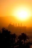 Cargo Ship in the Red Sea. Portrait orientation. A ship in Red Sea during sunset. Portrait orientation. Photo taken from Aqaba, Jordan stock image
