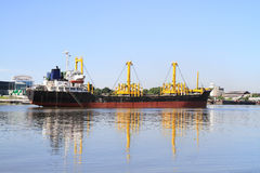 Cargo ship. With reflection in river Royalty Free Stock Photos